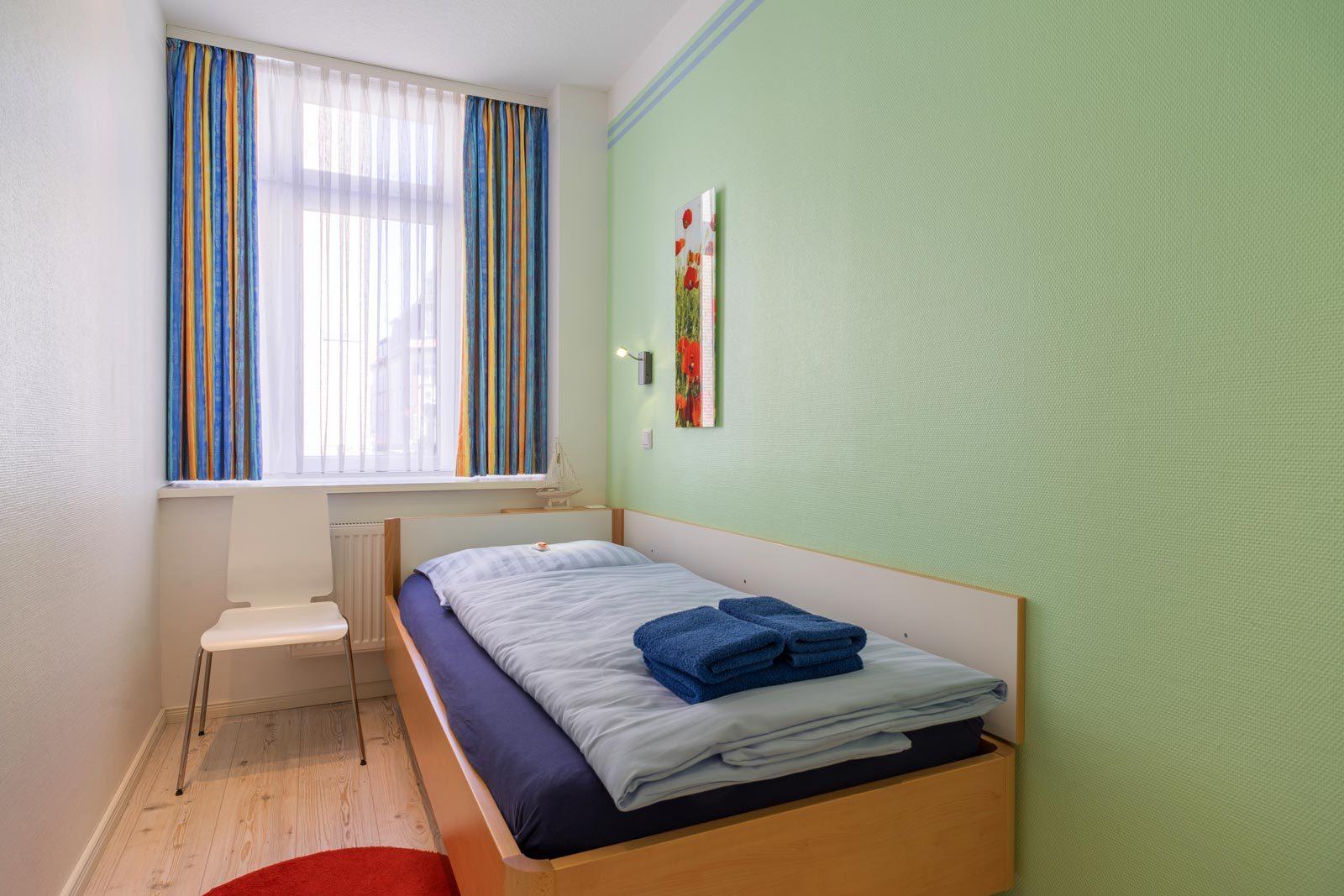 Einzelbett-Schlafzimmer Apartment Sonnendeck
