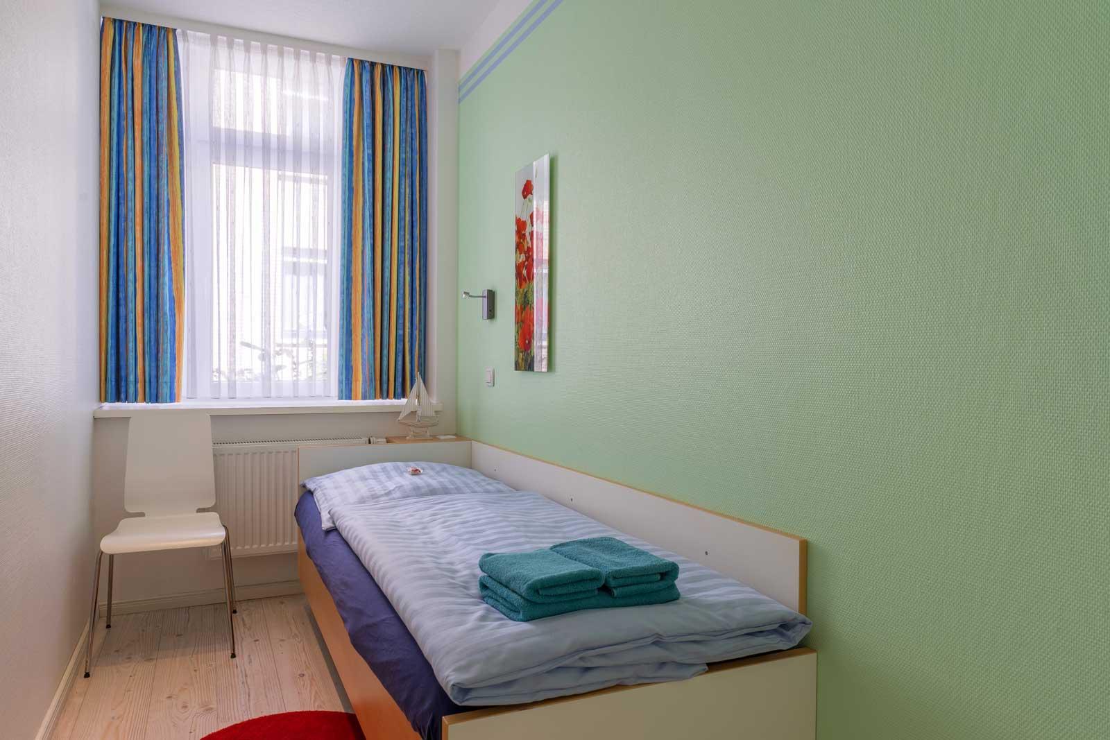 Einbettzimmer Apartment Achterdeck